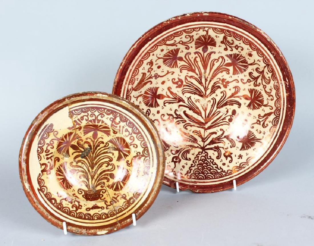 TWO HISPANO-MORESQUE CIRCULAR DISHES, 10ins and 7ins