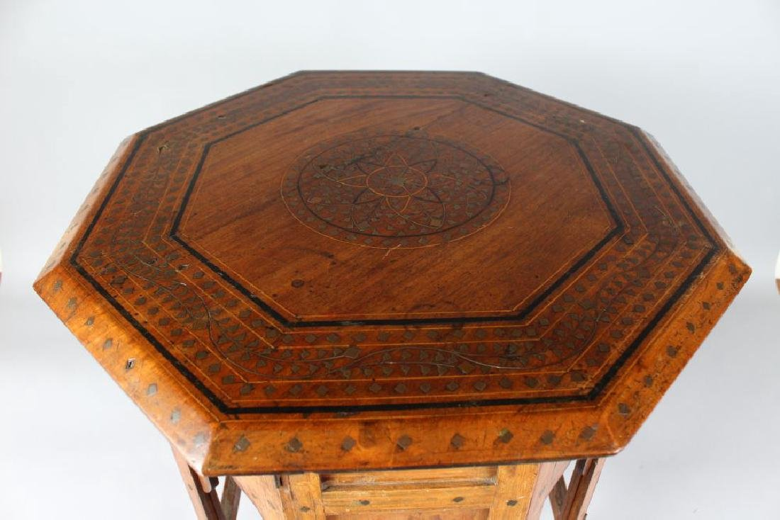 A GOOD ISLAMIC BRASS INLAID OCTAGONAL TABLE.  1ft 6ins - 3