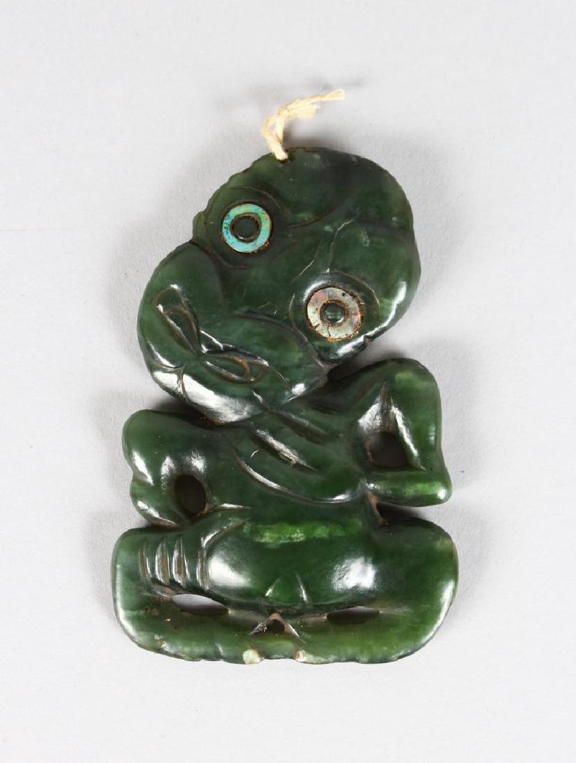 A MAORI HEI TIKI GREEN NEPHRITE, EARLY 19TH CENTURY,