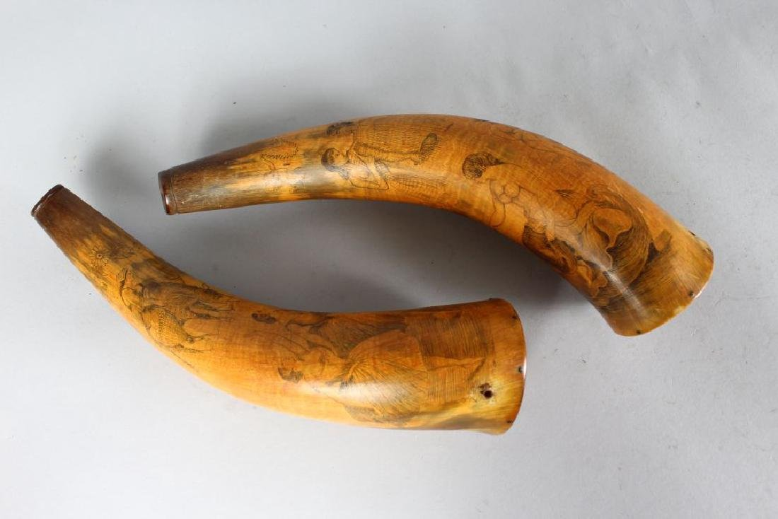 A PAIR OF MAORI FINELY CARVED HORN SCRIMSHAW POWDER