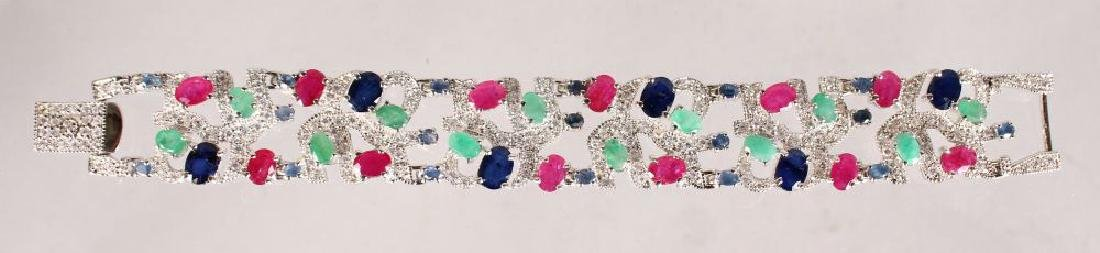 A SILVER, SAPPHIRE, RUBY AND EMERALD WIDE BRACELET.