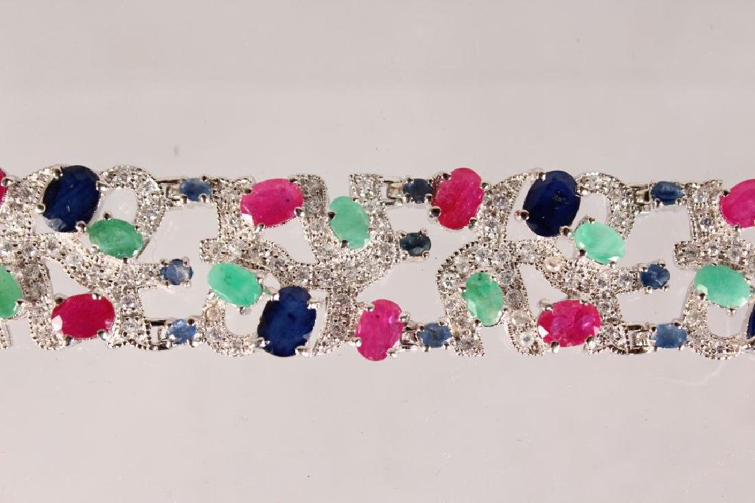 A SILVER, SAPPHIRE, RUBY AND EMERALD WIDE BRACELET. - 2