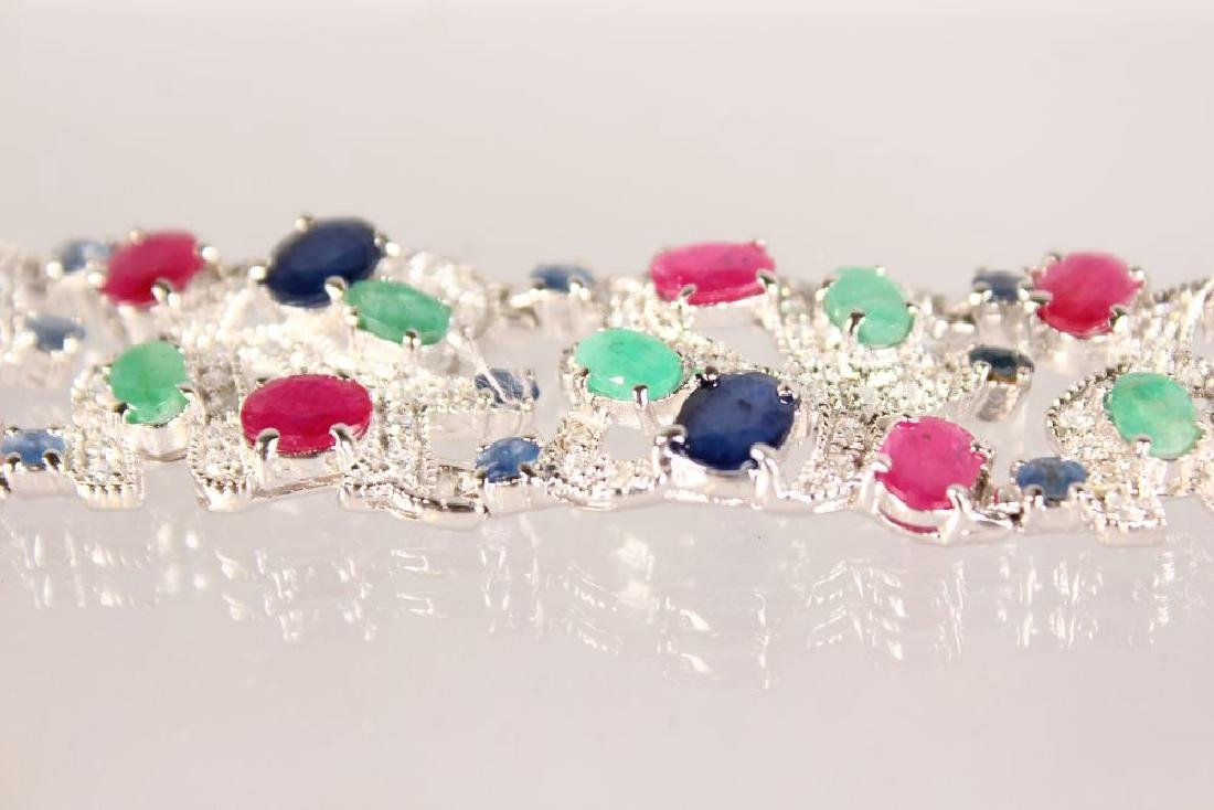 A SILVER, SAPPHIRE, RUBY AND EMERALD WIDE BRACELET. - 3