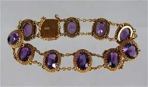 AN 18CT YELLOW GOLD AMETHYST BRACELET, set with ten