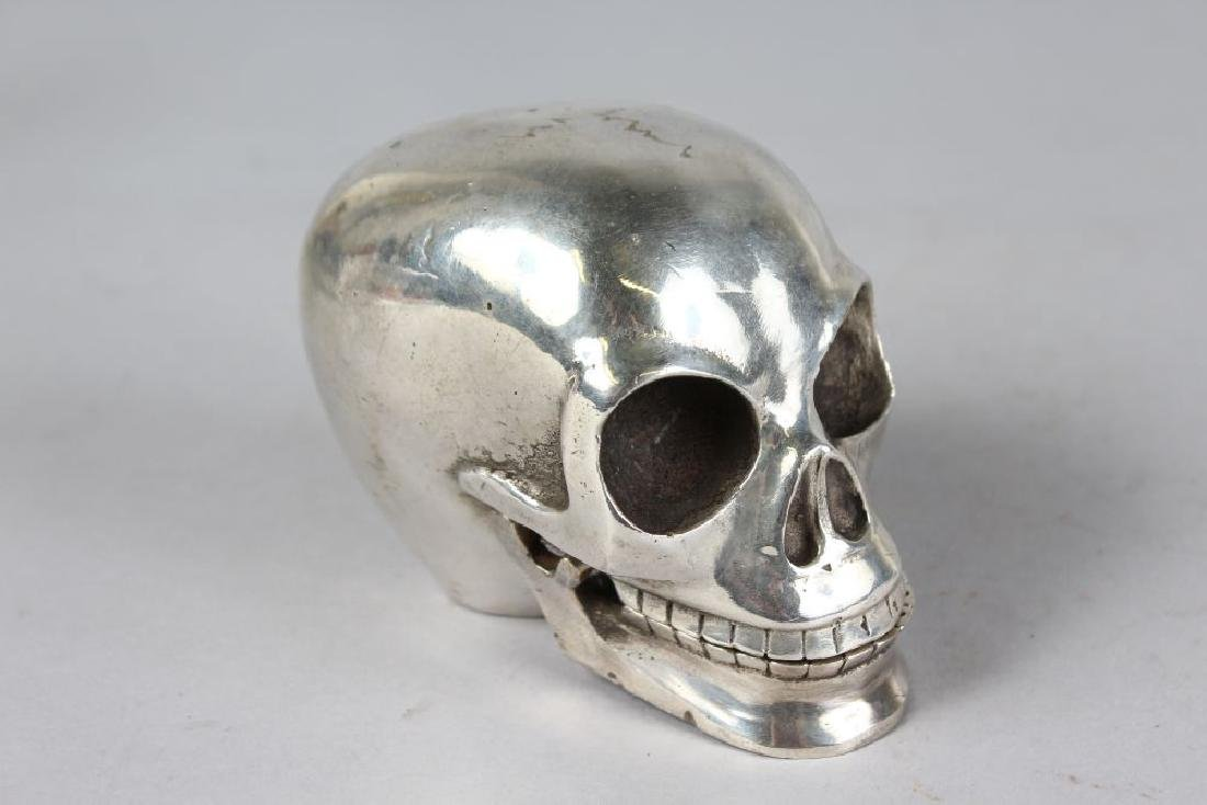 A SILVER PLATED SKULL.  5ins. - 2