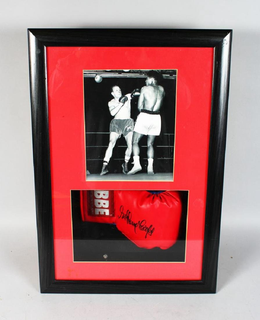 A SIGNED BRITANNIA BOXING GLOVE by HENRY COOPER, along