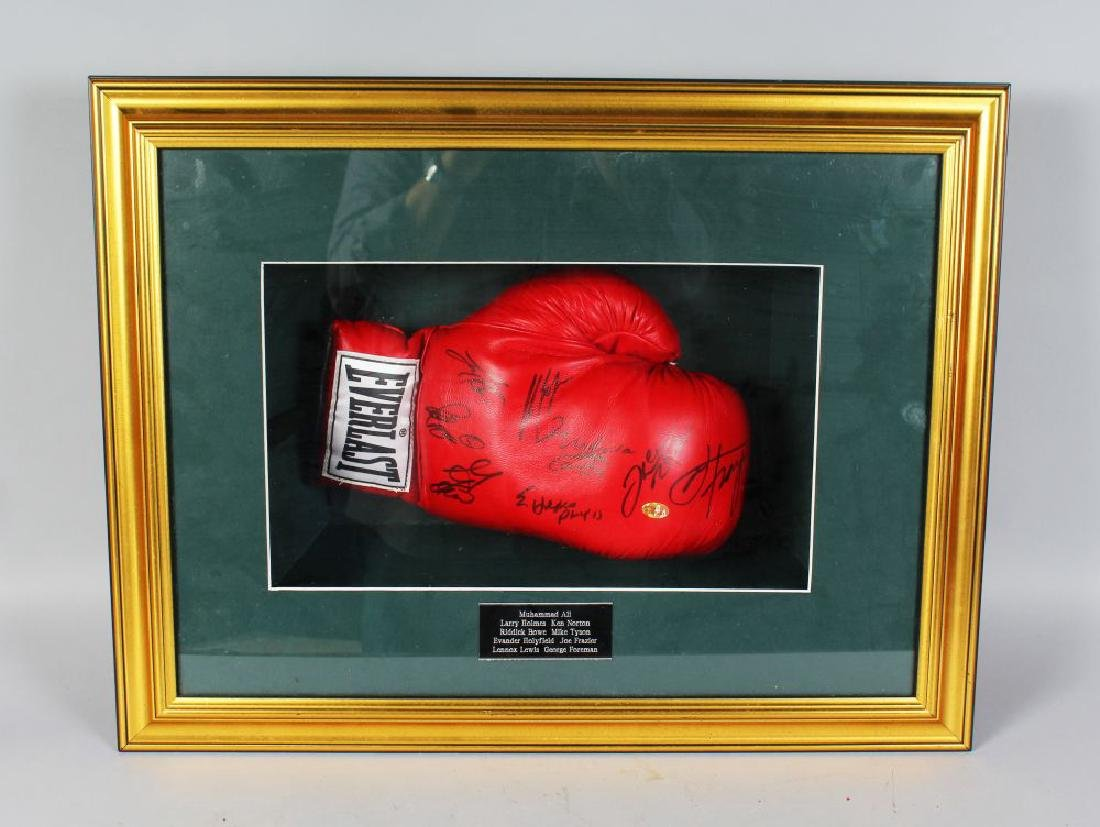 AN EVERLAST RED BOXING GLOVE, signed, by MUHAMMAD ALI,