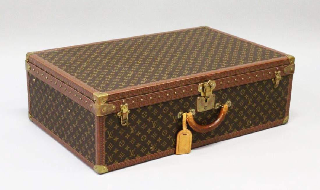 A LARGE LOUIS VUITTON CASE, No. 976574, AV. MARCEAU 78,