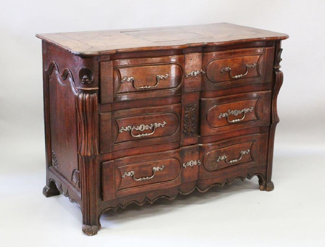 A VERY GOOD 18TH CENTURY FRENCH OAK COMMODE, three