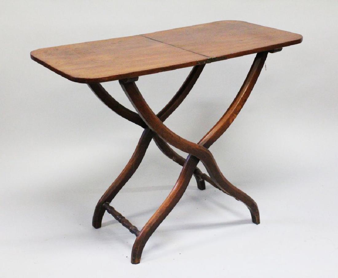 A 19TH CENTURY MAHOGANY FOLDING COACHING TABLE.