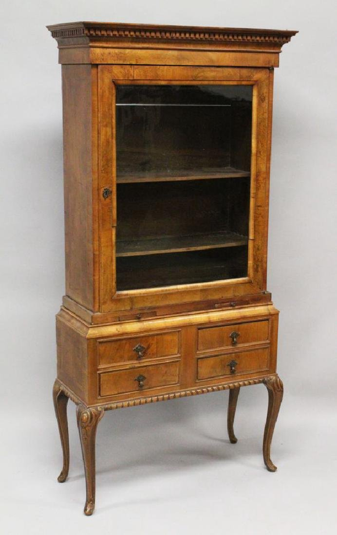 AN 18TH CENTURY WALNUT GLASS FRONTED CUPBOARD on a