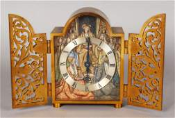 A SUPERB SMALL GILT METAL CLOCK by GUBELIN, LUCERNE,