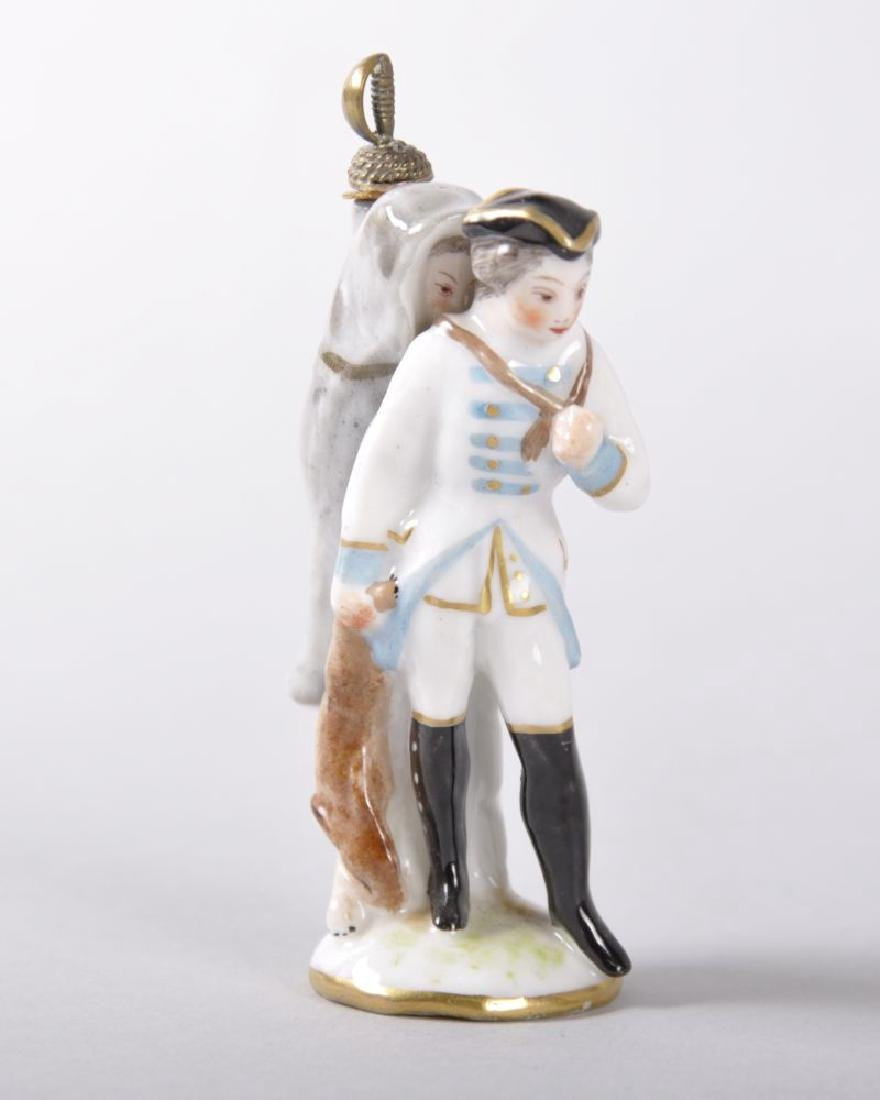 A 19TH CENTURY PORCELAIN PERFUME BOTTLE OF A SOLDIER,