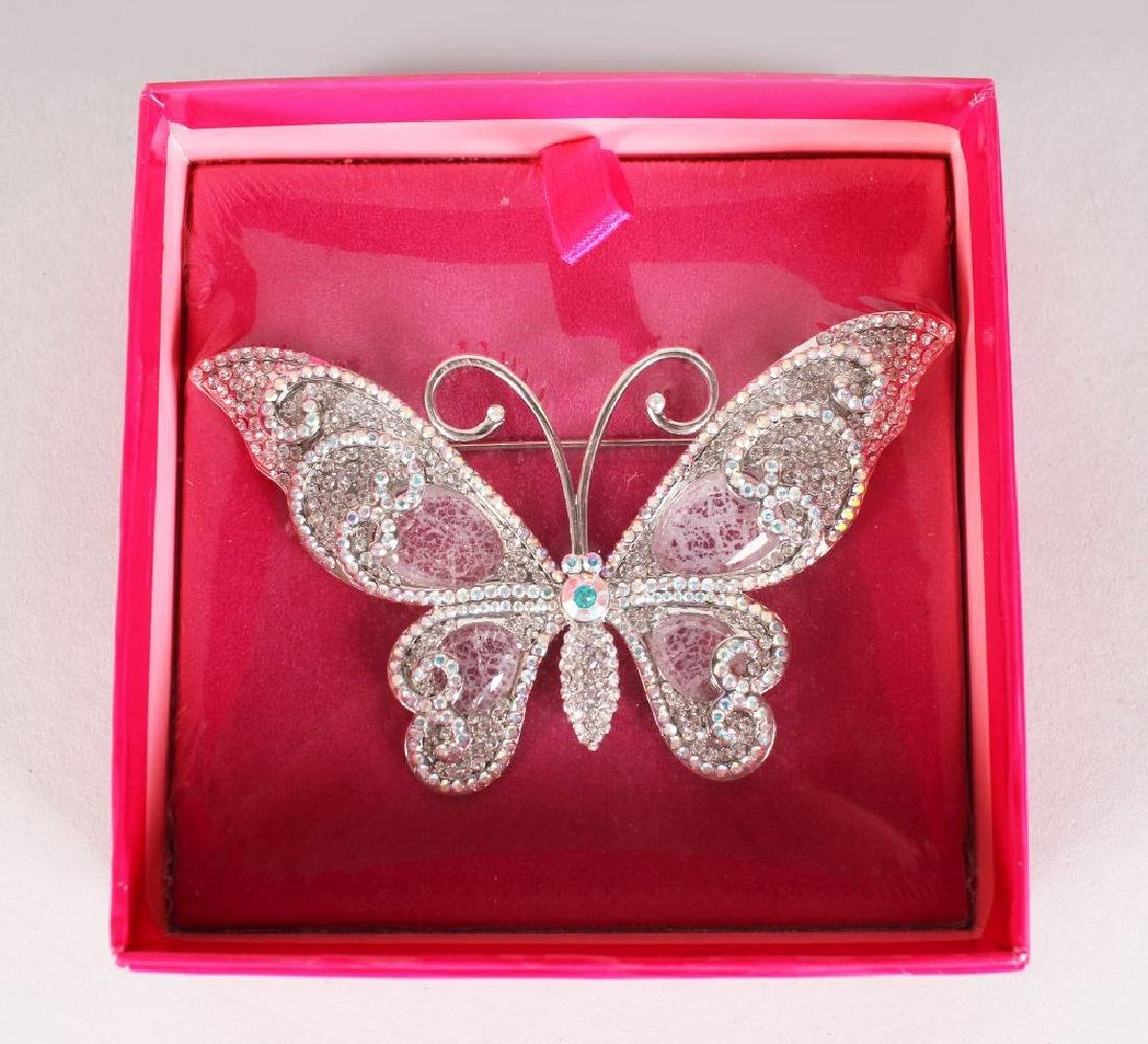A BUTLER & WILSON BUTTERFLY BROOCH, boxed.  3ins long.