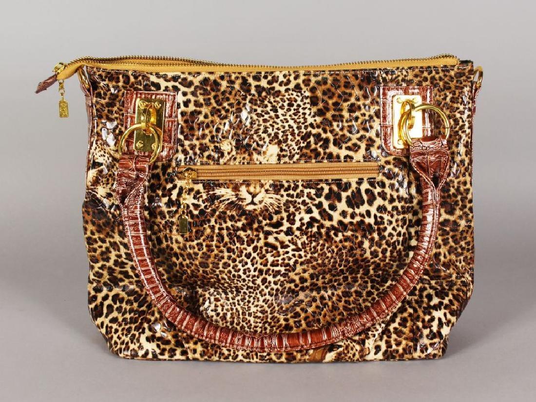 A BUTLER & WILSON LEOPARD PRINT BAG AND PURSE.  11ins x
