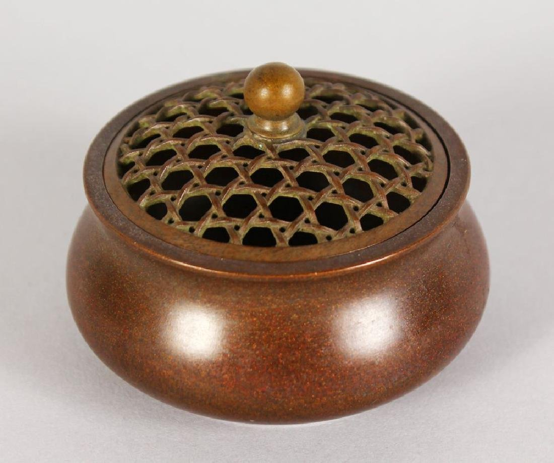 A LARGER CHINESE BRONZE CIRCULAR CENSER with pierced