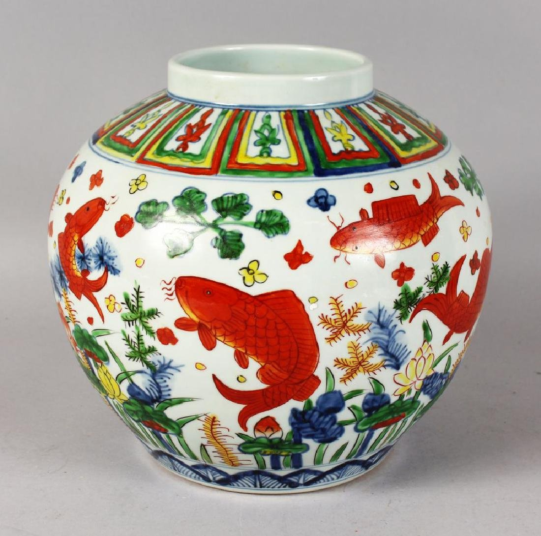 A CHINESE VASE painted with fish.  9.5ins high.