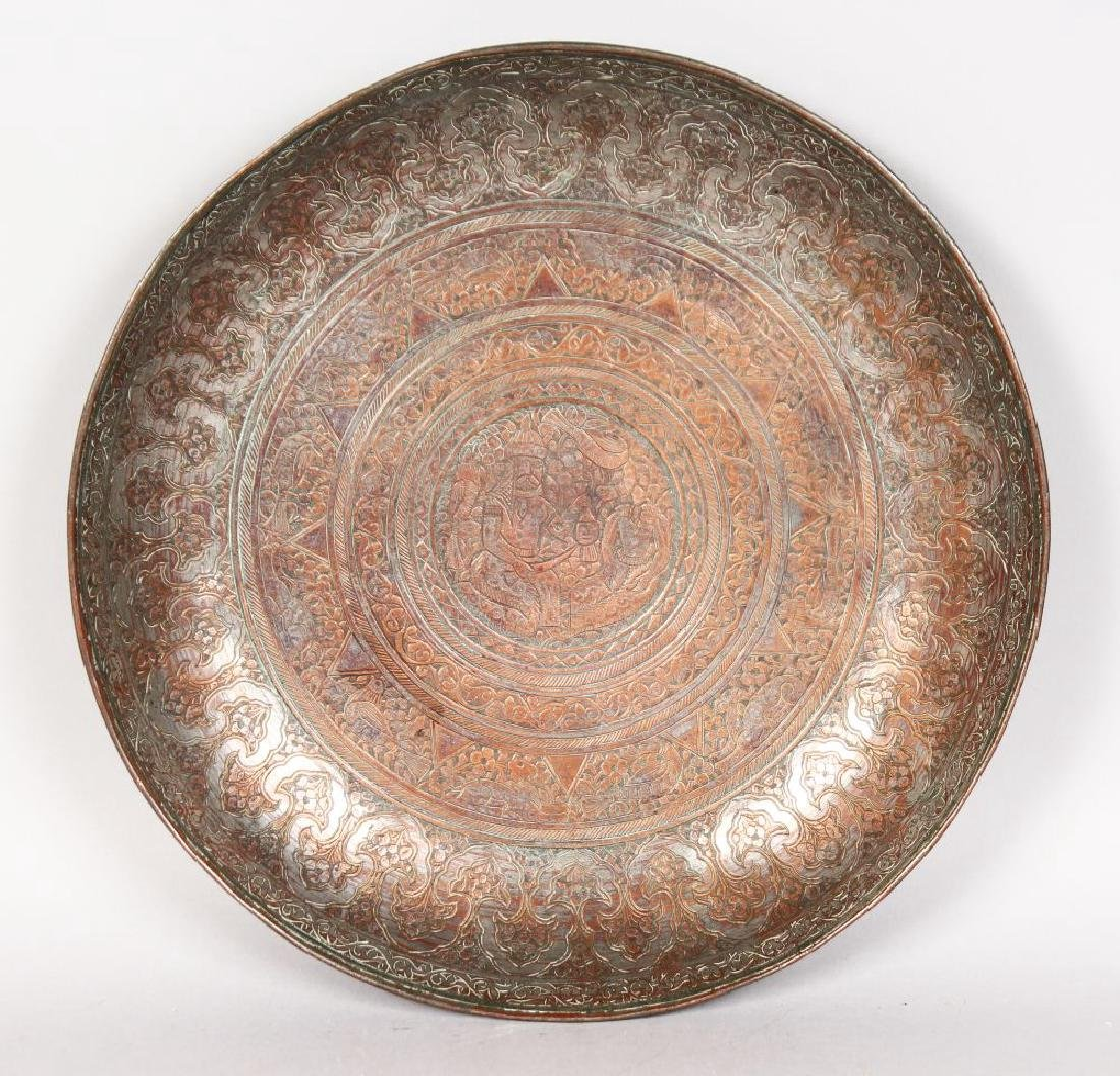 A ISLAMIC SILVER ON COPPER CIRCULAR DISH.  10.5ins
