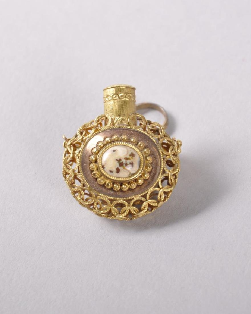 A GOOD SMALL REGENCY GOLD FILIGREE OVAL SHAPED PERFUME