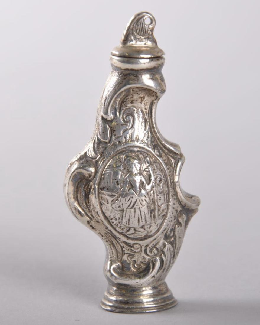 A 19TH CENTURY DUTCH SILVER SHAPED PERFUME BOTTLE AND