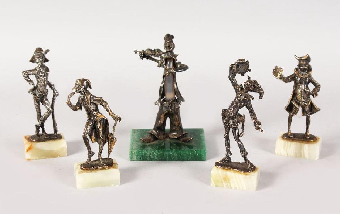 FIVE CONTINENTAL SILVER MUSICIANS ETC on marble bases.