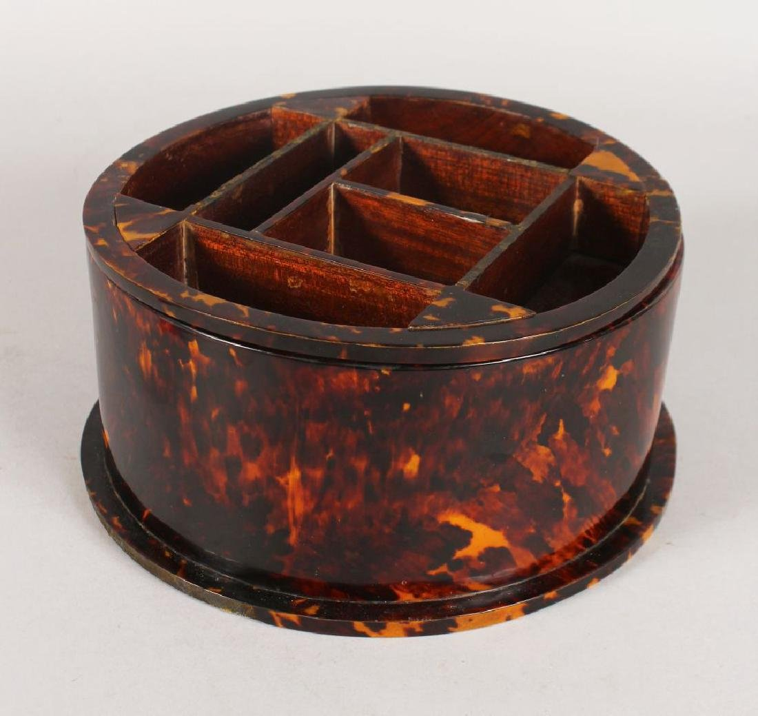 A CIRCULAR TORTOISESHELL ROUND SECTION BOX with lift