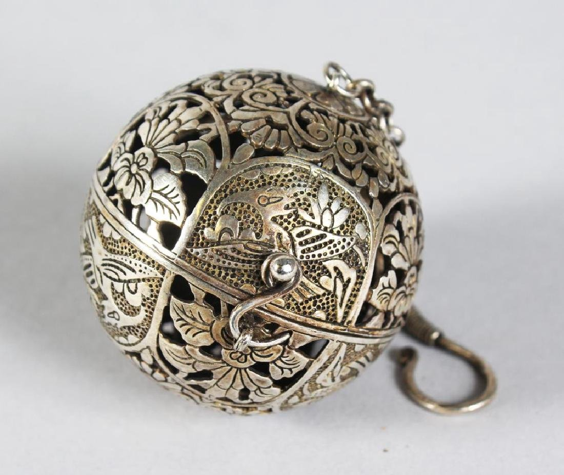 A CHINESE PIERCED SILVER TRAVELLING CENSER.  2ins