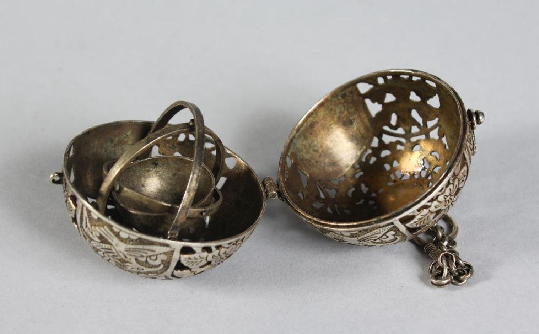 A CHINESE PIERCED SILVER TRAVELLING CENSER.  2ins - 2