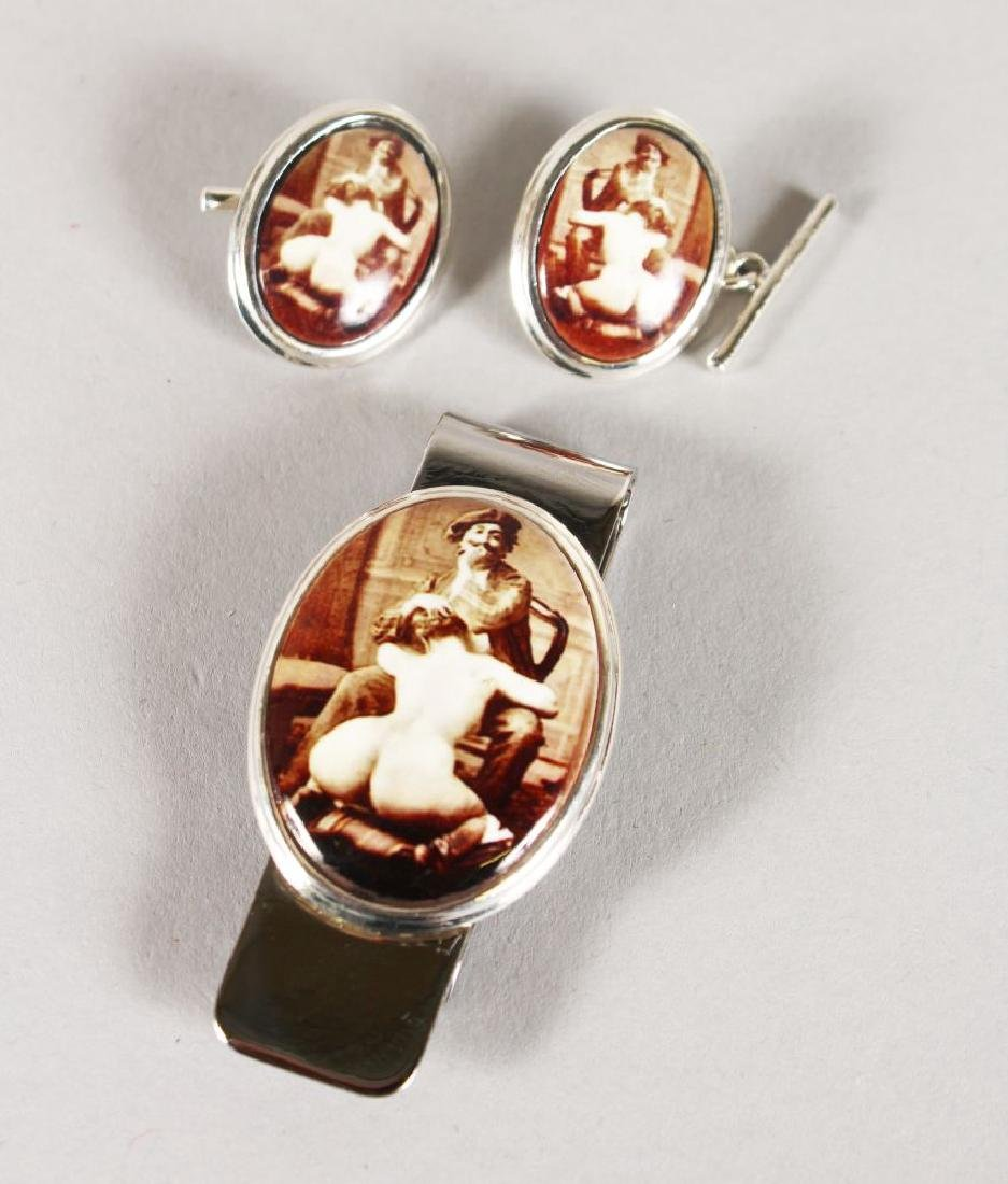 A SILVER EROTIC MONEY CLIP AND CUFFLINKS.