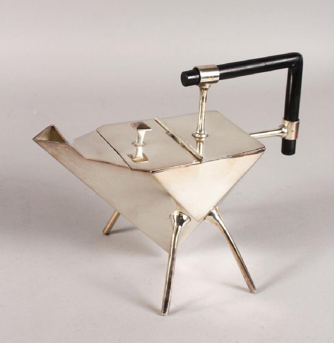 AN ART DECO CHRISTOPHER DRESSER DESIGN DIAMOND TEAPOT.