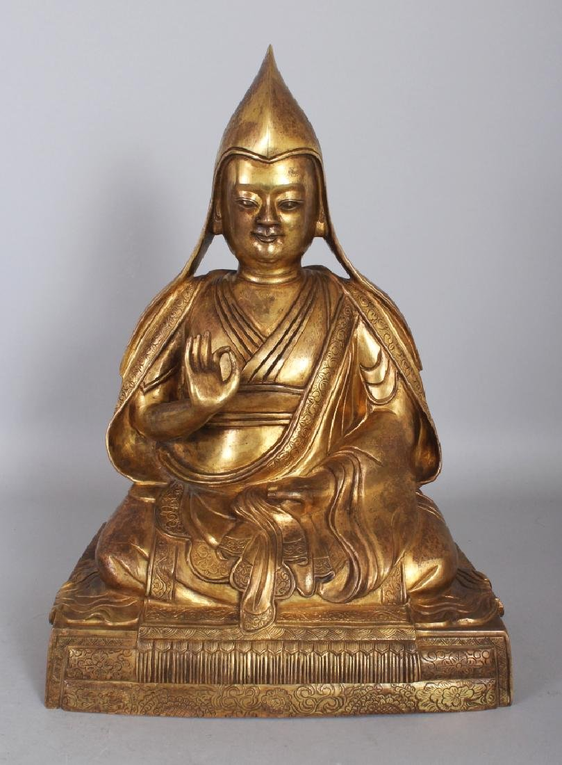 A LARGE GOOD QUALITY TIBETAN GILT BRONZE FIGURE OF A