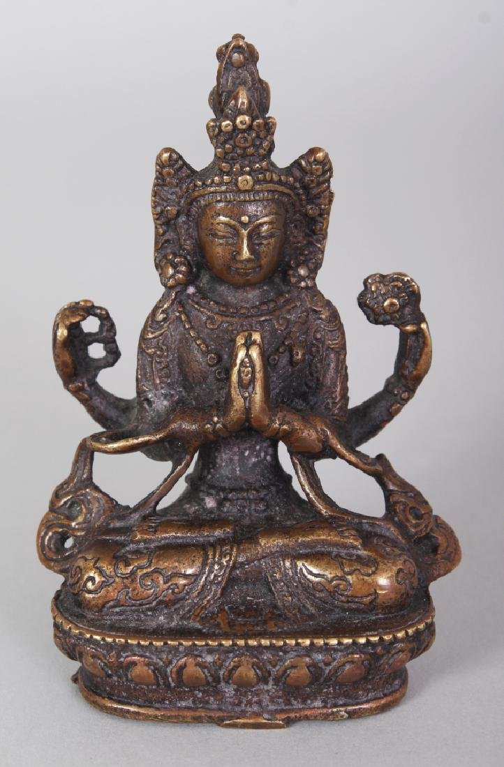 A SMALL 19TH CENTURY TIBETAN BRONZE BUDDHA, the base