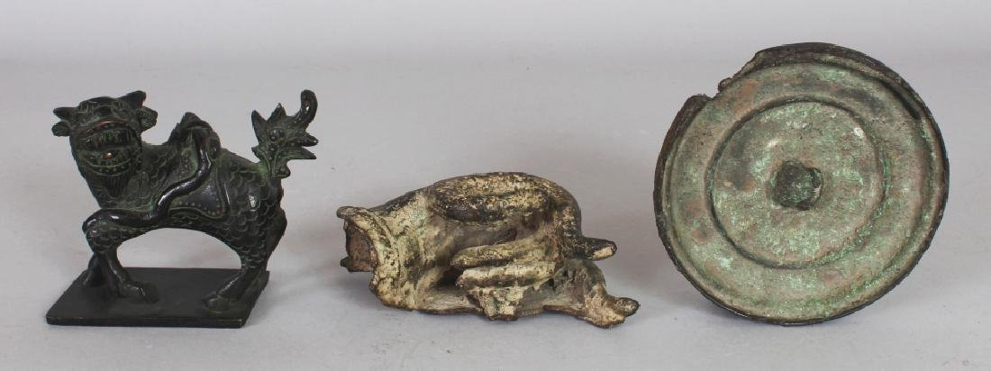 AN EARLY CHINESE BRONZE HAND MIRROR, 4.3in diameter; an