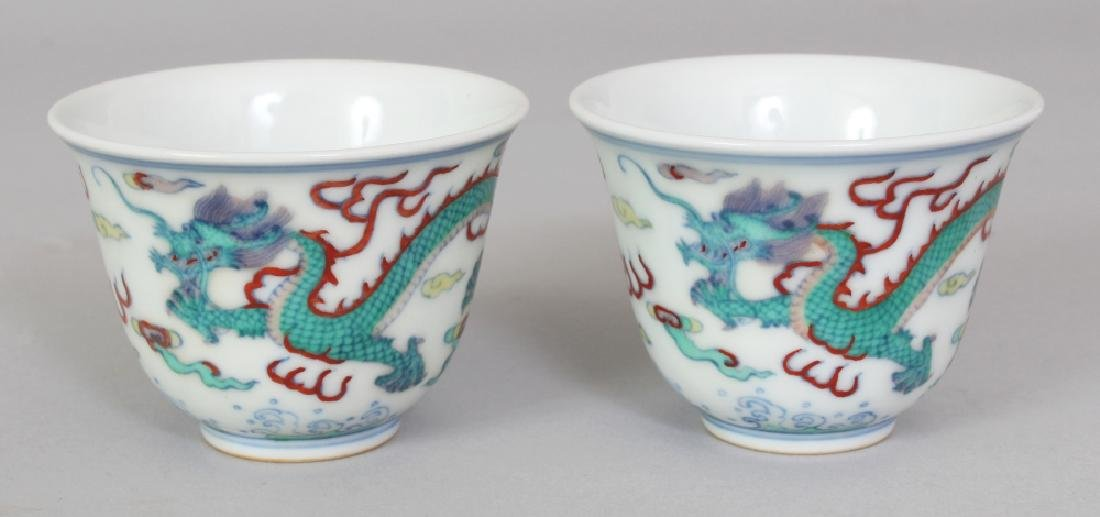 A PAIR OF CHINESE DOUCAI PORCELAIN DRAGON WINE CUPS,