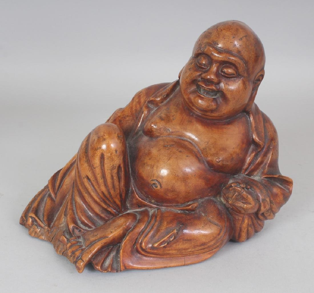 A 19TH/20TH CENTURY CHINESE CARVED HARDWOOD FIGURE OF