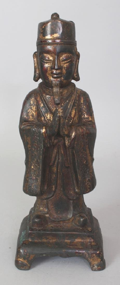 A CHINESE MING STYLE GILT BRONZE FIGURE OF A STANDING