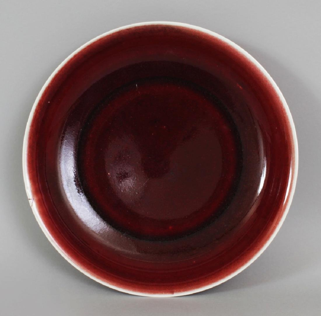 A CHINESE COPPER RED PORCELAIN DISH, the base with a