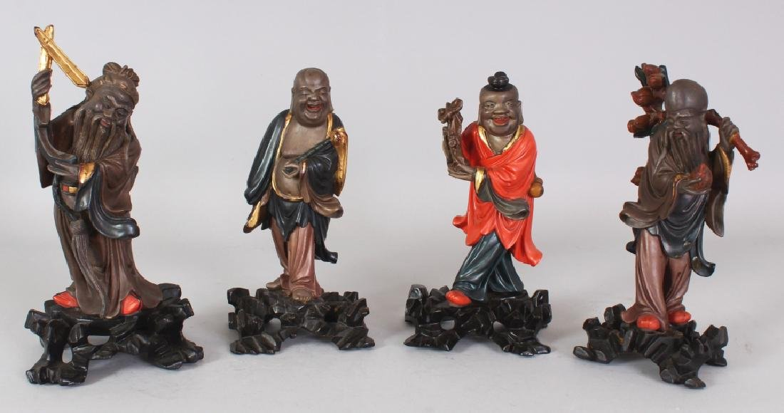 A GROUP OF FOUR EARLY 20TH CENTURY CHINESE LACQUERED