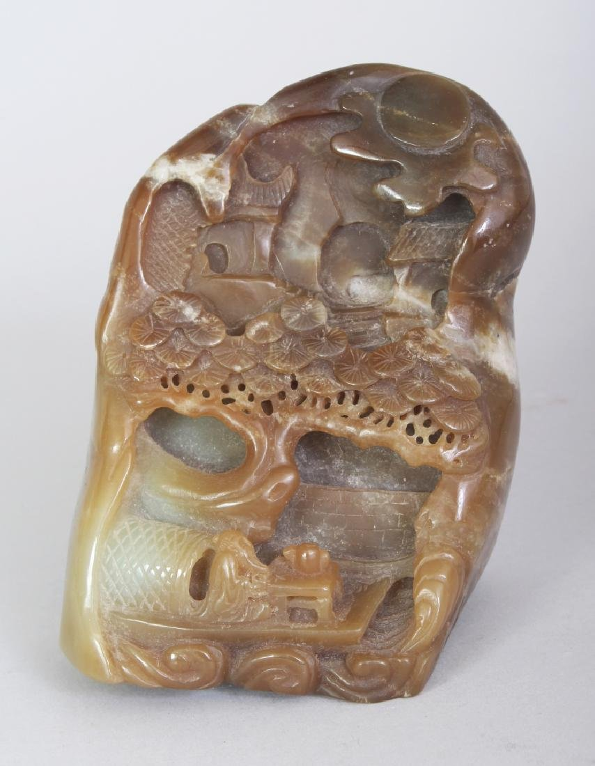 A CHINESE BROWN JADE BOULDER, carved in deep relief