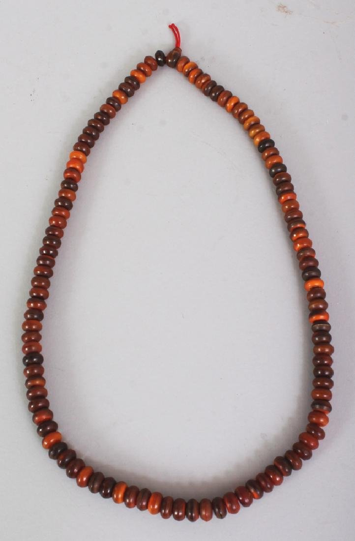 A HORN NECKLACE, weighing 89.1gm, composed of flattened