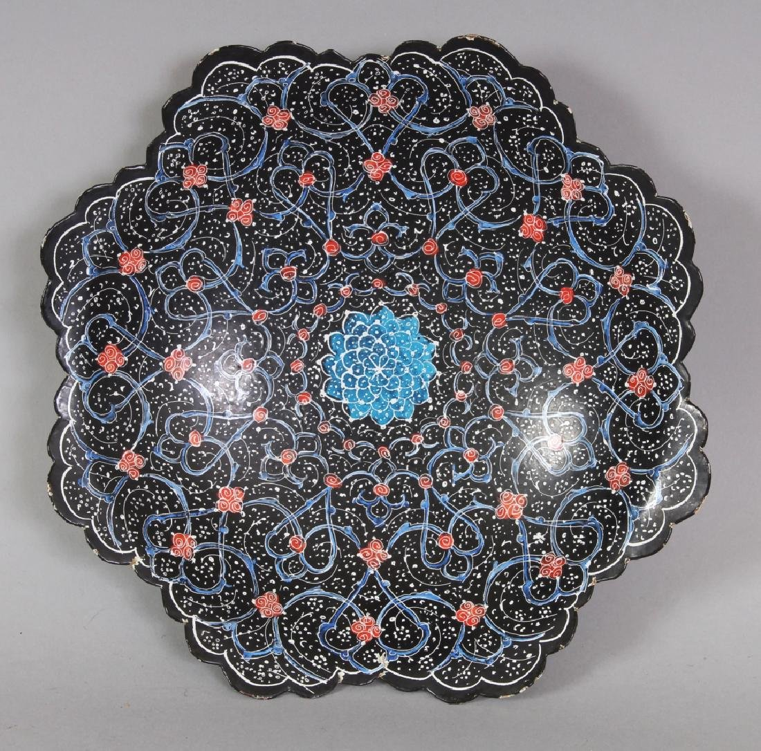 AN INDO-PERSIAN ENAMELLED METAL OCTOFOIL DISH, with a