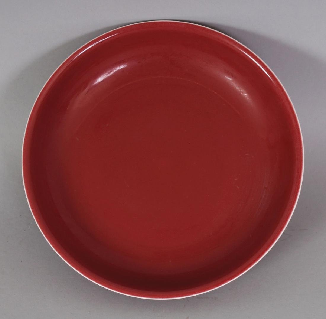 A CHINESE MING STYLE COPPER RED PORCELAIN SAUCER DISH,