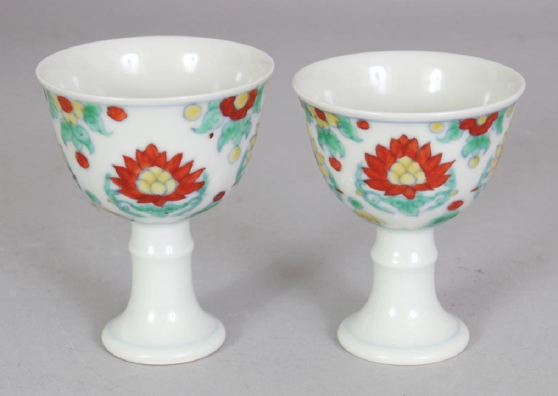 A PAIR OF CHINESE DOUCAI LOTUS DECORATED PORCELAIN STEM