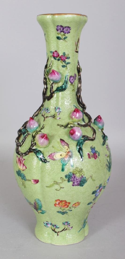 A CHINESE LIME GREEN GROUND FAMILLE ROSE MOULDED