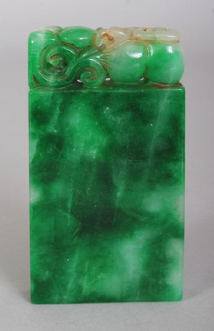 A CHINESE APPLE-GREEN JADE TABLET, 3.25in x 1.75in.