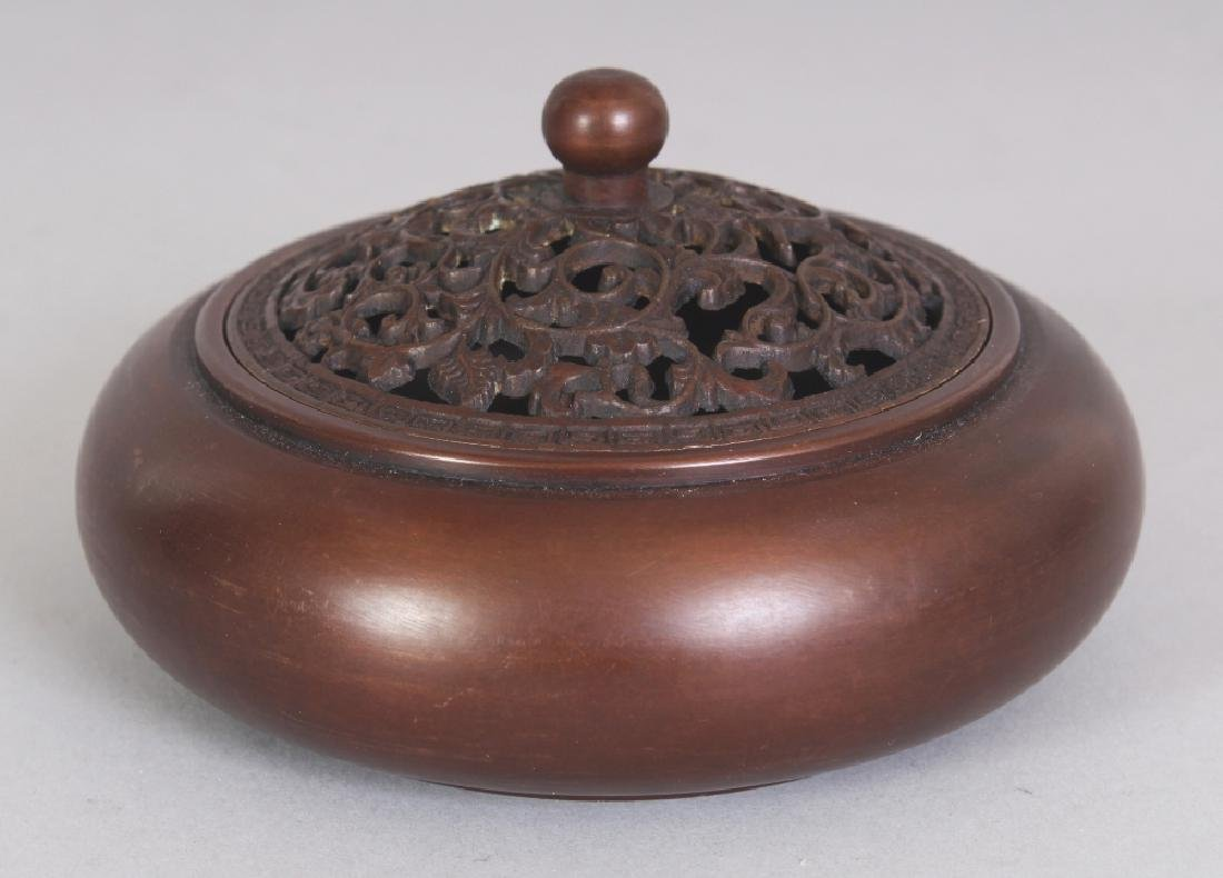A SMALL CHINESE CIRCULAR BRONZE CENSER & PIERCED COVER,