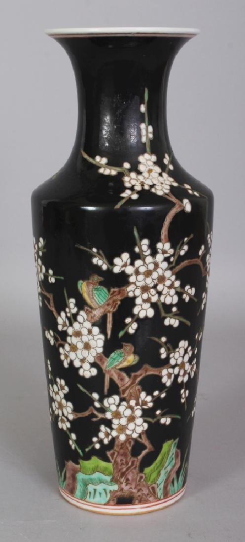 A CHINESE FAMILLE NOIRE PORCELAIN VASE, the base with a