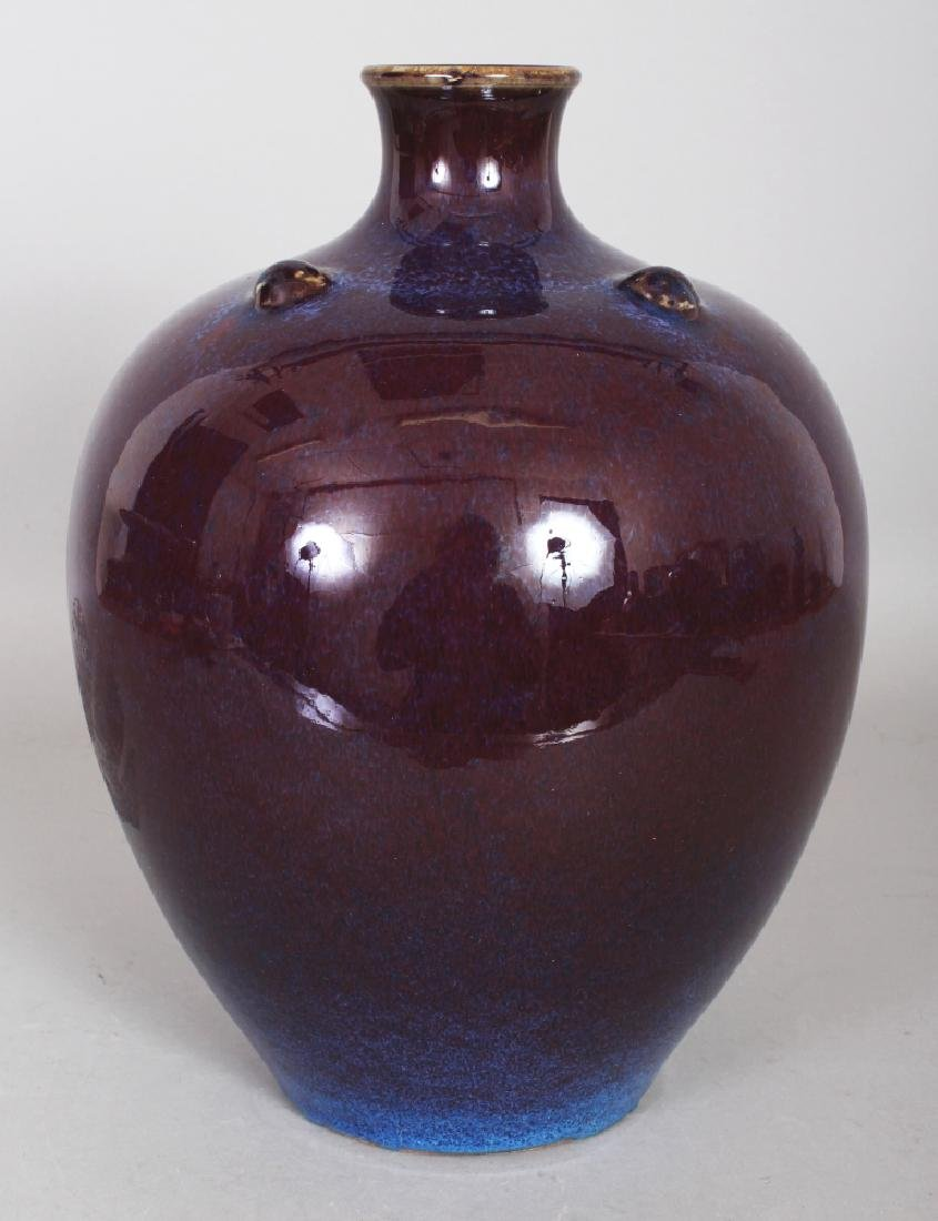 A CHINESE FLAMBE GLAZED OVOID VASE, the shoulders