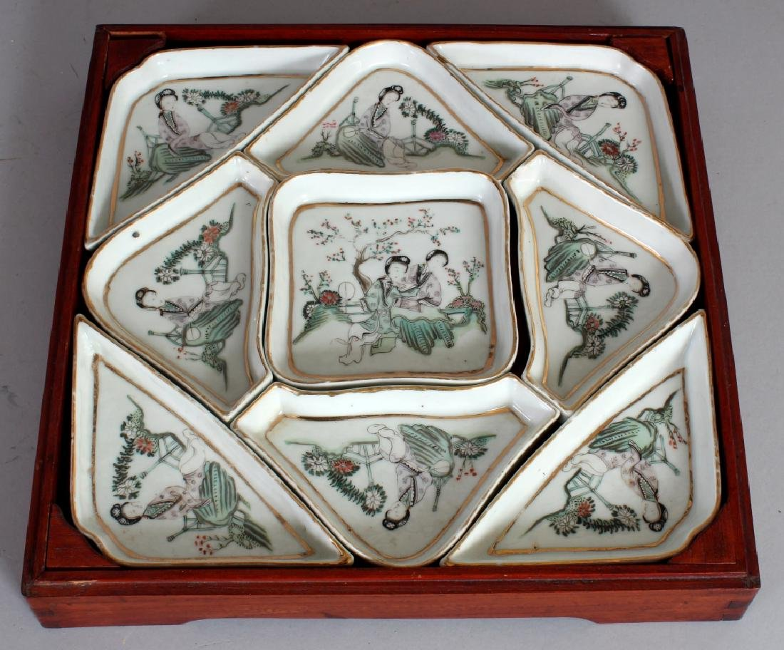 AN EARLY 20TH CENTURY NINE PIECE FAMILLE ROSE PORCELAIN