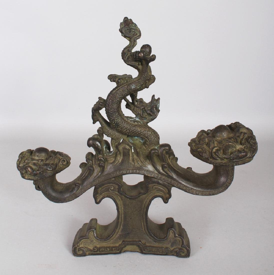 AN UNUSUAL CHINESE BRONZED METAL DRAGON ORNAMENT, the